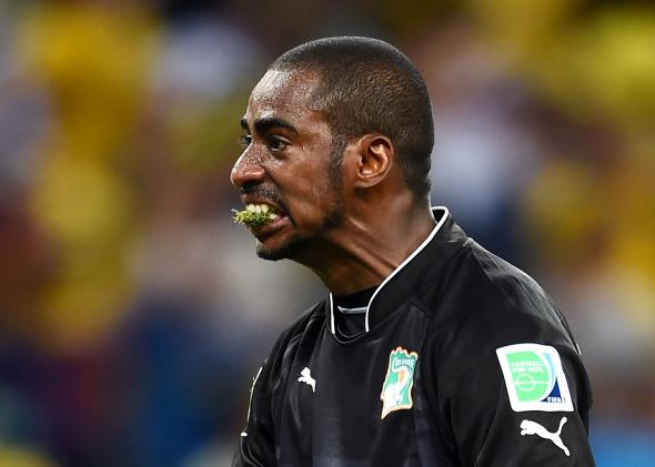 451173074-boubacar-barry-of-the-ivory-coast-celebrates-with-grass.jpg.crop.promo-mediumlarge.jpg