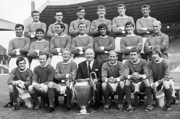 manchester_united_european_cup_winning_team_poses_with_the_trophy_at_old_trafford_1968.jpg