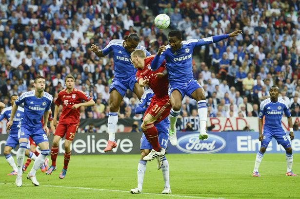 bastian_schweinsteiger_of_bayern_munich_competes_for_possession_with_chelseas_didier_drogba_and_john_obi_mikel-840758.jpg