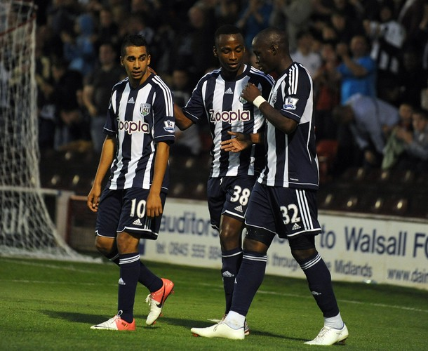 saido_berahino_c_of_west_bromwich_albion_celebrates_after_he_sores_a_goal_with_team-mates_marc_antoine_fortune_r_and_yassine_el_ghannsay_l.jpg