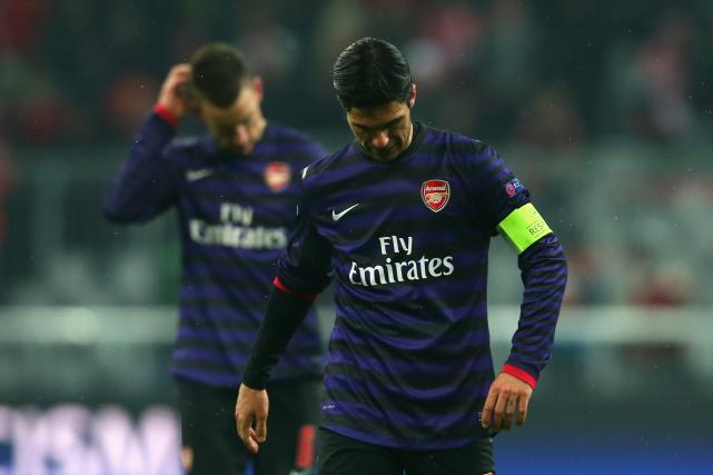 Champions League last-16 results: Arsenal are out despite 2-0 win over Bayern, Malaga sink Porto
