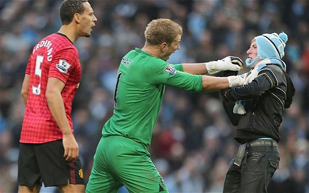 Man City fan banned for three years for coming up against Ferdinand