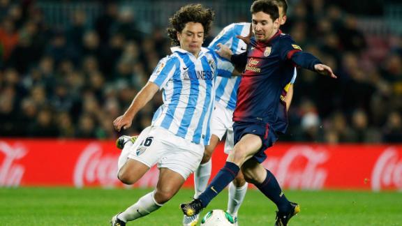 Barca stumbles on Malaga